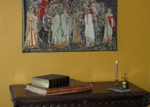 The Arming of the Knights tapestry - woven in four sizes. Here above a late Victorian gothic table