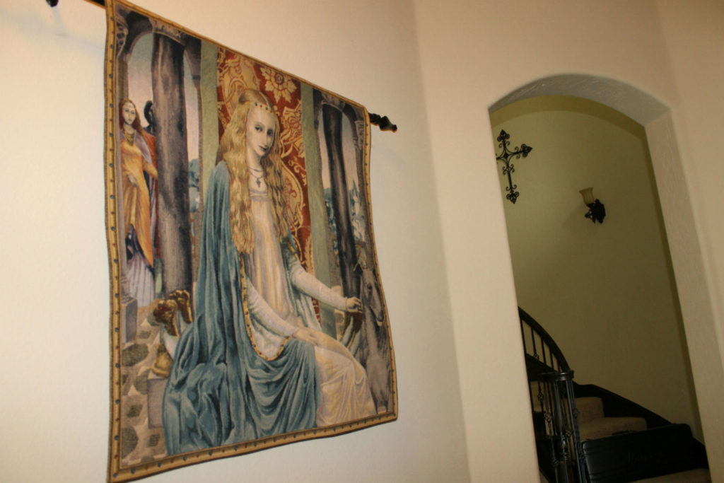 The Lady tapestry wallhanging is a Belgian tapestry showing a scene in Camelot with King Arthur being brought into the presence of Queen Guinevere
