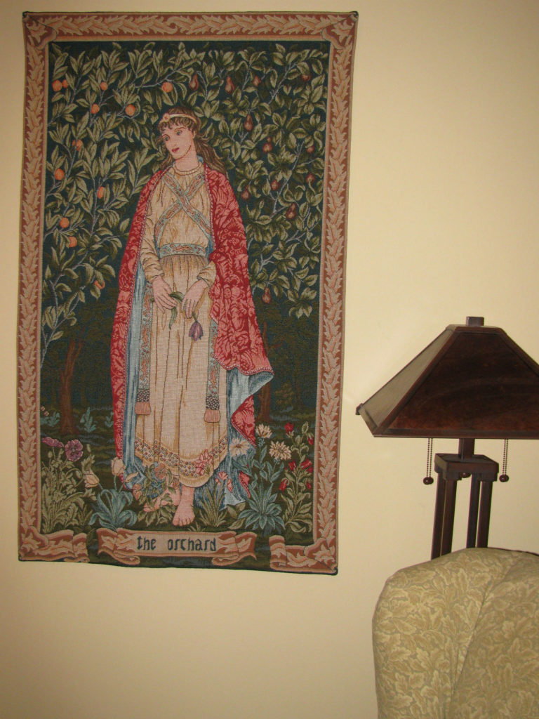 The Orchard by William Morris shows one of four figures in The Seasons tapestry designed by William Morris and John Henry Dearle