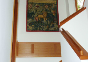 The Lion from the Quest tapestry hanging in a stairwell - half of the full Quest for the Holy Grail tapestry