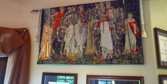 The Arming of the Knights tapestry was originally designed by Edward Burne-Jones as the second in the Quest for the Holy Grail tapestries series