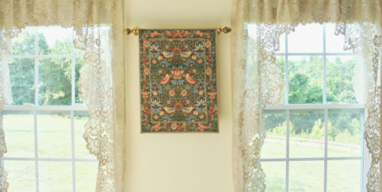 The Strawberry Thief wall tapestry is adapted from one of the William Morris designs