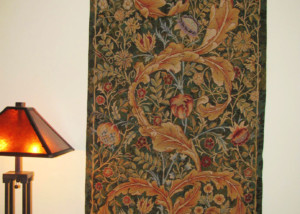 The William Morris portiere wall tapestry demonstrates Morris design skills, seen here in an Arts and Crafts setting